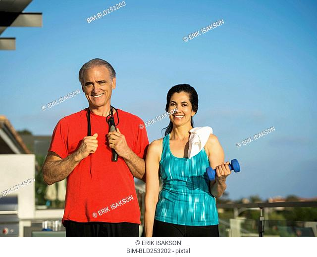 Portrait of older couple resting outdoors after workout