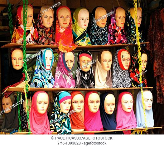 mannequin heads covered with a variety of colourful hijabs , shop selling hijabs , kuala lumpur, malaysia