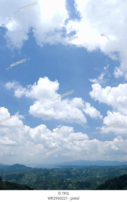Blue sky with white cloud in sunny day, horizon with mountains