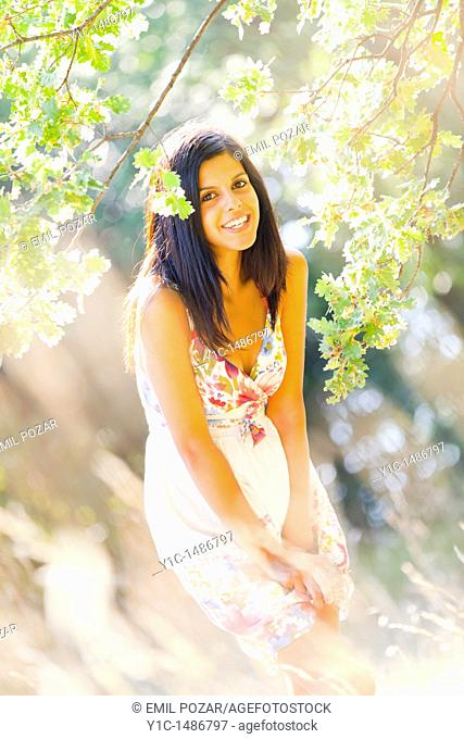 Attractive woman very happy in the woods