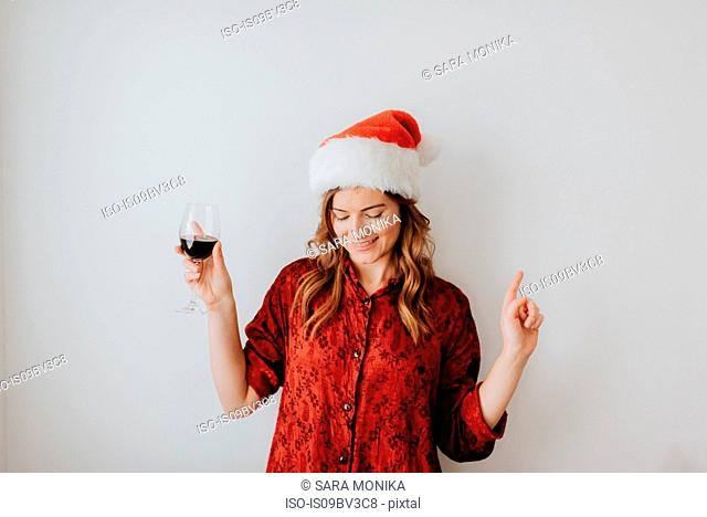Woman dancing with wine, white background