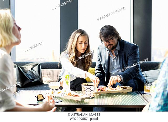 Business people having meal in restaurant