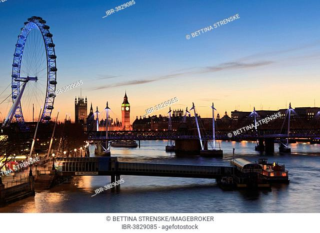 View of the River Thames with the London Eye and the Houses of Parliament at dusk, London, England, United Kingdom