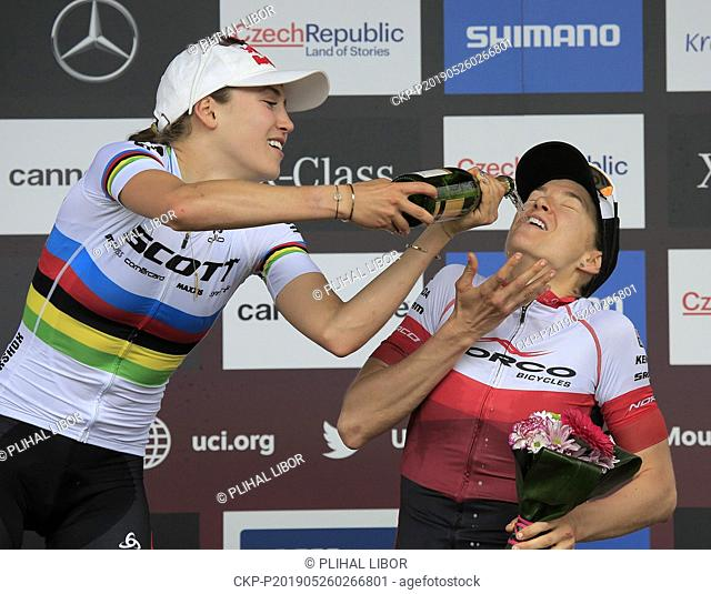 From left winner KATE COURTNEY of USA and bronze HALEY SMITH of Canada on the stage after the women elite Cross Country Mountain Bike World Cup event in Nove...
