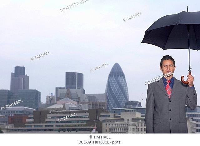 Mann with umbrella city scape