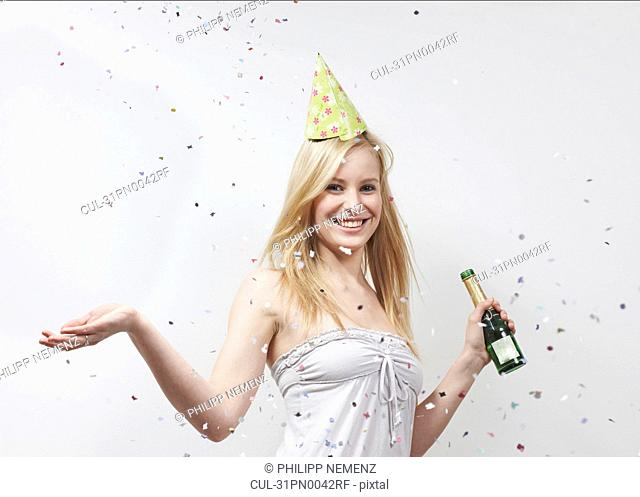 Woman with funny hat and confetti