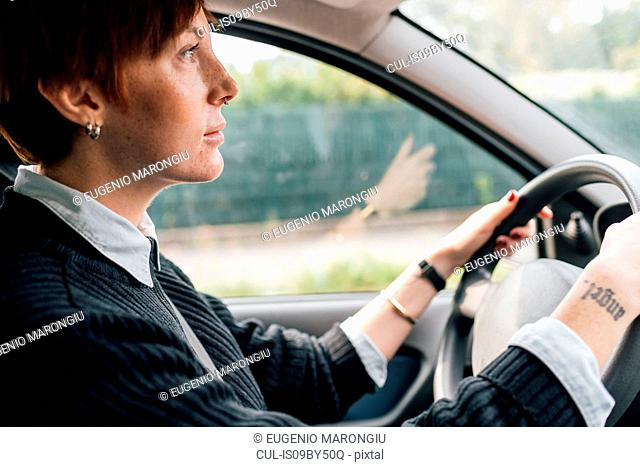 Woman concentrating on driving car
