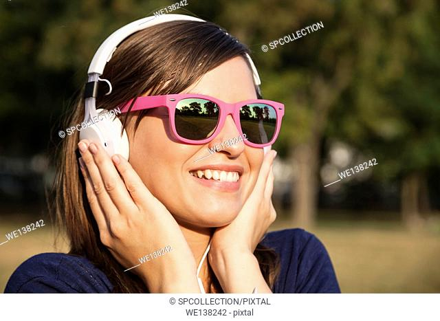 Woman listening music in park