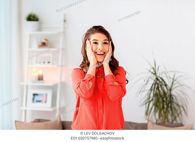 emotion, facial expression people concept - happy young woman at home