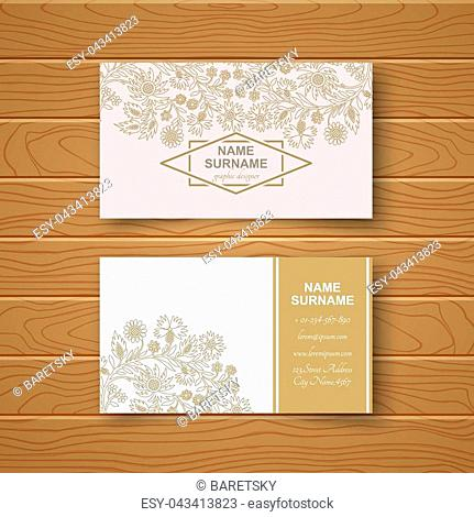Template of the blank business card on a wooden table.Card with a flower pattern with a realistic shadow. Vector illustration