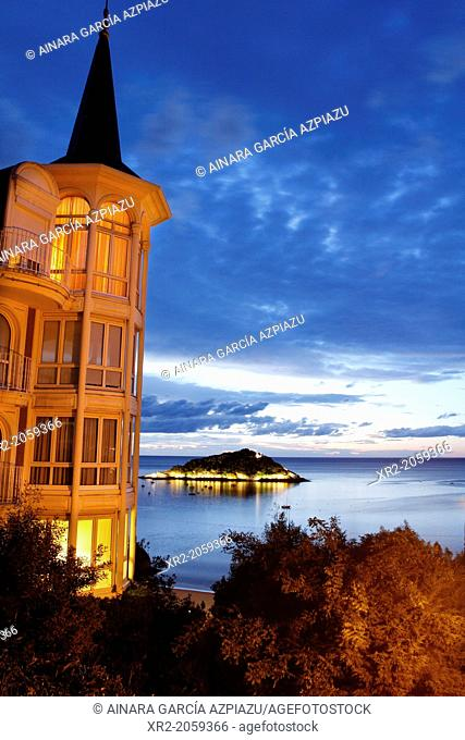 Blue hour in Santa Clara island viewed from the houses of Miraconcha in Donostia - San Sebastian, Basque Country, Spain