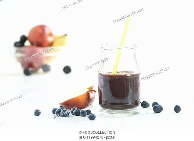 Blueberry smoothie, fresh blueberries and half an apple