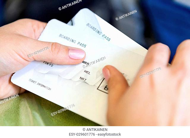 Close up view of Caucasian female hands with boarding passes