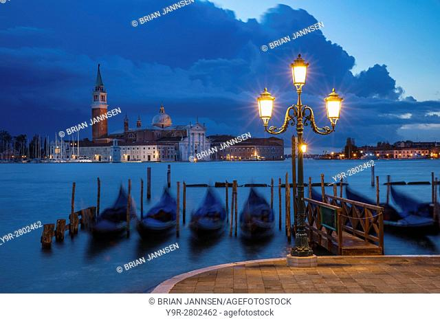 Early morning view over Gondolas and San Giorgio Maggiore, Venice, Veneto, Italy