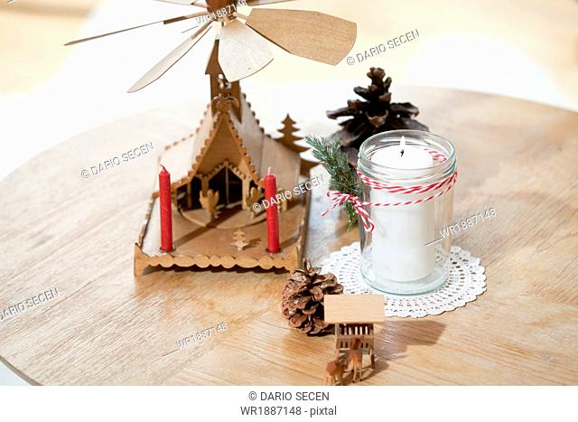 Christmas decoration, fir cones, pyramid and candle, Munich, Bavaria, Germany