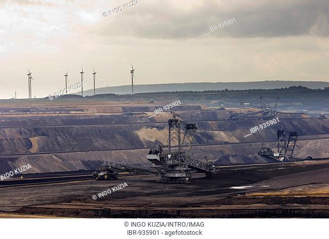 Garzweiler brown-coal open cast mine, in the back a wind power station, North Rhine-Westphalia, Germany, Europe
