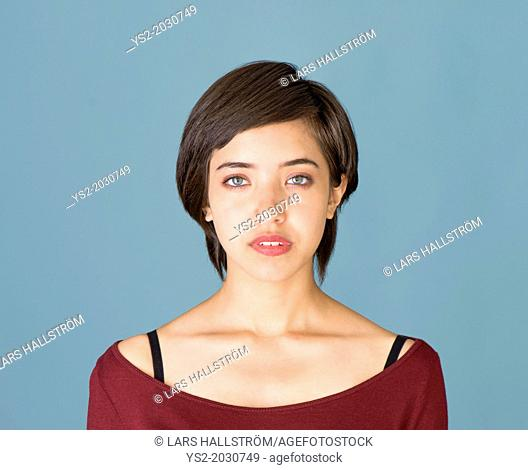 Portrait of confident and natural young multiracial woman.	1015
