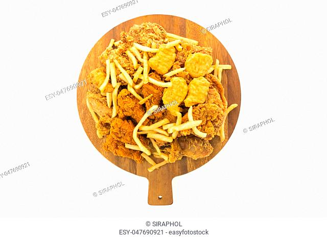 French fries and fried chicken on wooden plate isolated on white background - Unhealthy food style