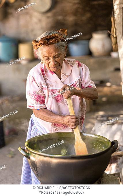 An elderly Oaxacan Zapotec cook prepares traditional food at El Sabor Zapoteco Cooking School in Teotitlan, Mexico
