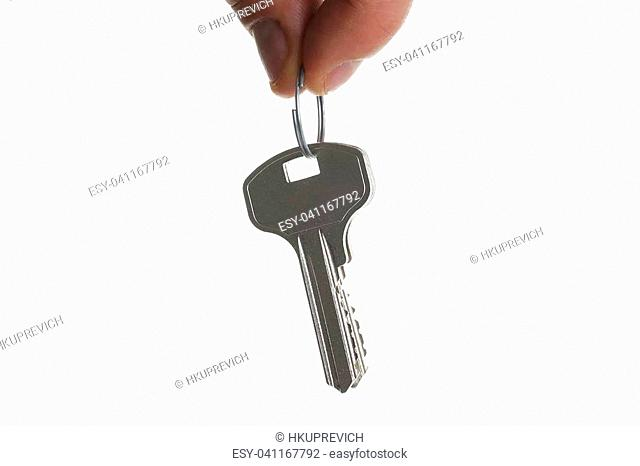 A male hand holds a metal bunch of keys from the apartment door isolated on a white background