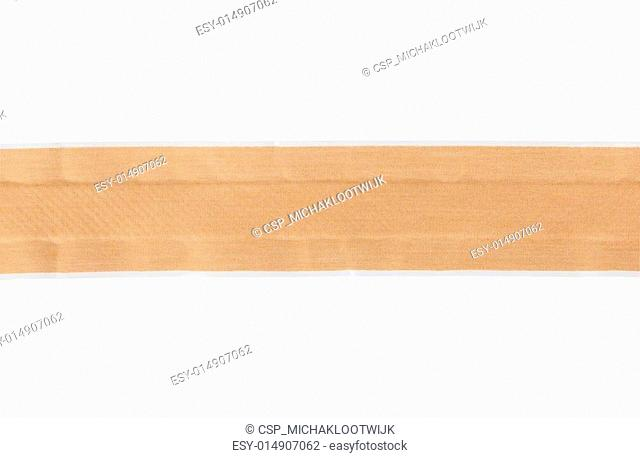 Roll of bandaid adhesive plaster isolated