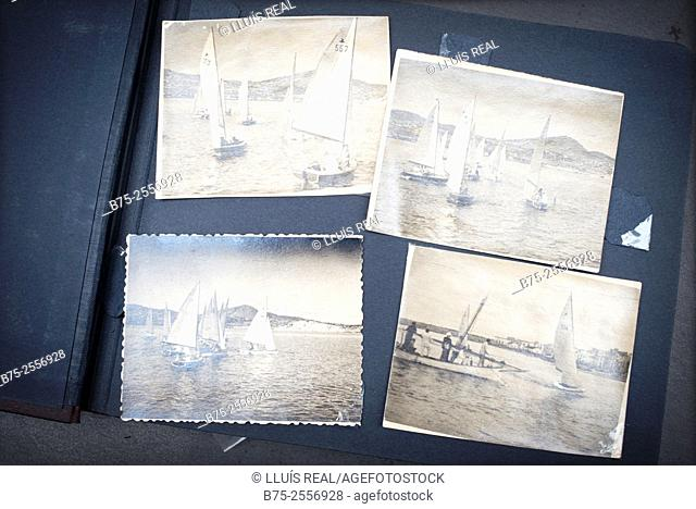 Page of old photo album with black and white pictures of sailing boats, snipe type. Menorca, Port Mahón, Mediterranean sea, Balearic Islands, Spain, Europe