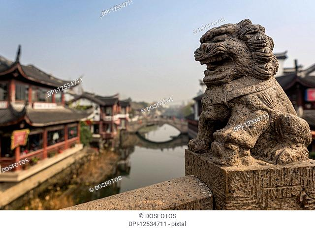 Lion sculpture on one of Qibao Old Town bridges, Minhang District; Shanghai, China