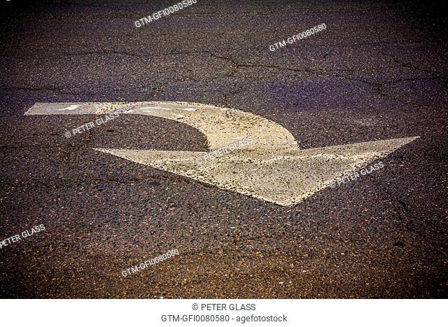 Traffic arrow painted on the street