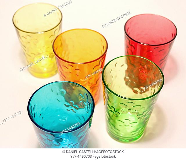 Five color glasses on white table