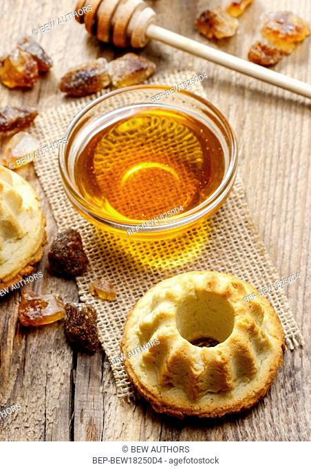 Bowl of honey on wooden table. Symbol of healthy living and natural medicine. Aromatic and tasty
