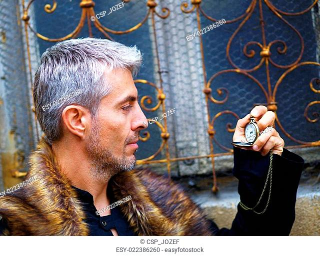 handsome elegant man with pocket watch and wolf fur