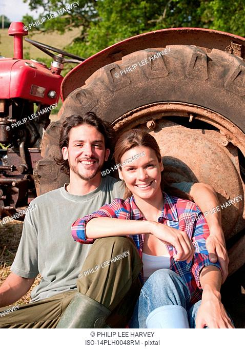 couple sat by tractor