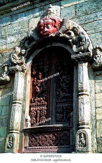 NEPAL, KATHMANDU VALLEY, PASHUPATINATH, SHAIVITE TEMPLE CARVED DOOR