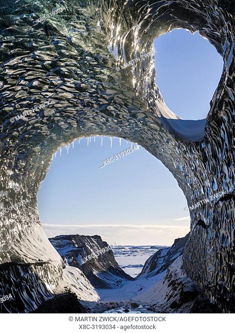 Ice cave at the northern shore of glacial lagoon Joekulsarlon in glacier Breidamerkurjoekull in Vatnajoekull NP. Europe, Northern Europe, Iceland