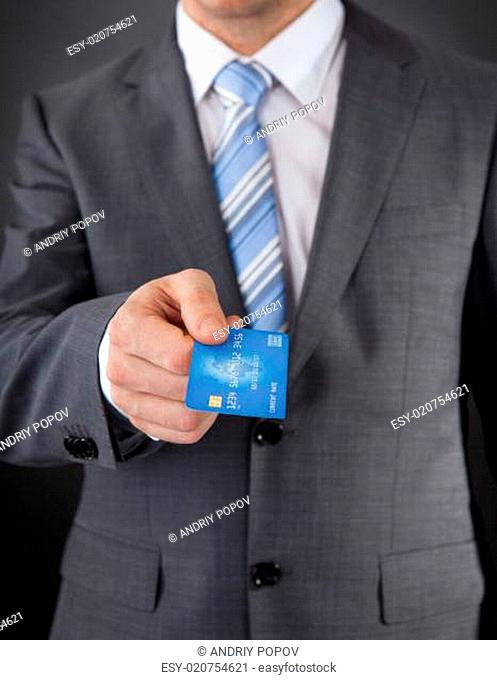 Businessman Giving His Credit Card