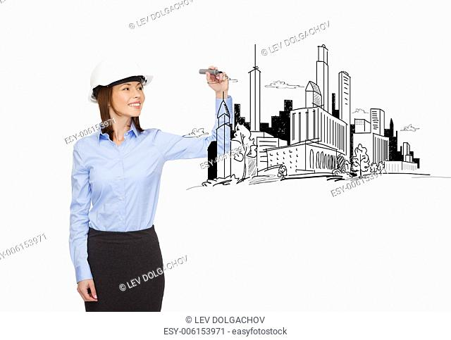 building, developing, consrtuction and architecture concept - smiling businesswoman in white helmet drawing city plan on virtual screen