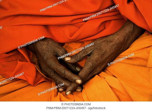 Mid section view of a sadhu praying, Varanasi, Uttar Pradesh, India