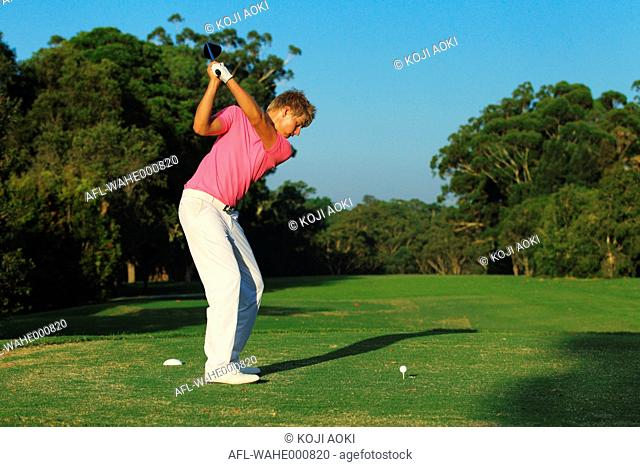 Golfer Concentrating on Tee