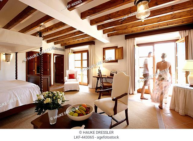 Couple inside a hotel suite, Deia, Majorca, Spain