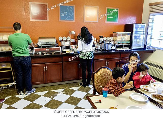 Florida, FL, Orlando, Kissimmee, Comfort Inn, hotel, inside, breakfast room, free, included, Asian, mother, boy, son, girl, daughter, family, eating