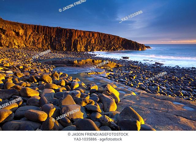 England, Northumberland, Cullernose Point  Dawn light illuminates the rocky shoreline of Cullernose Point, near the village of Craster on the Northumberland...