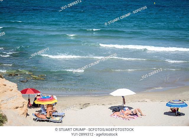 Sunbathers on the beach at Torre de la Horadada in Alicante Spain