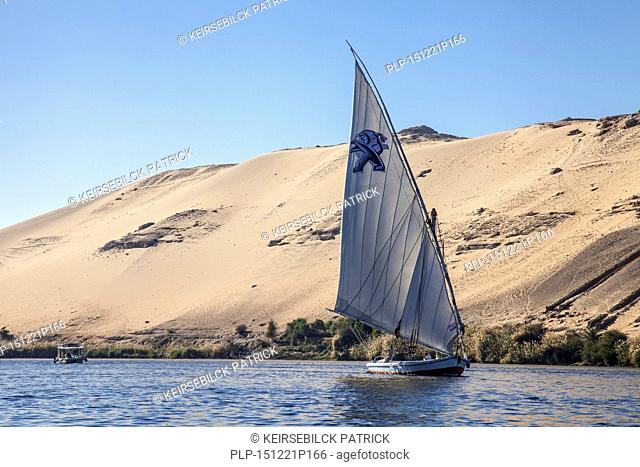 Felucca, traditional wooden sailing boat on the river Nile near Aswan southern Egypt