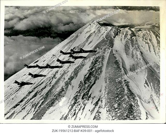 Dec. 12, 1956 - American Cougars Fly by Mount Fujiyama - Japan.: A flight of F9F-8 Cougars from VF-121 deployed aboard one of the carriers assigned to the...