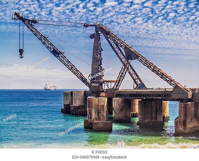 Viña del Mar, February 2011. Abandoned crane structure for shipping on ruined Vergara dock