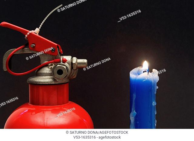 Fire extinguisher and candle