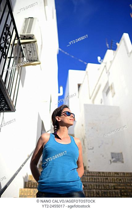 Young woman in the streets of Mojácar, Almería, Spain