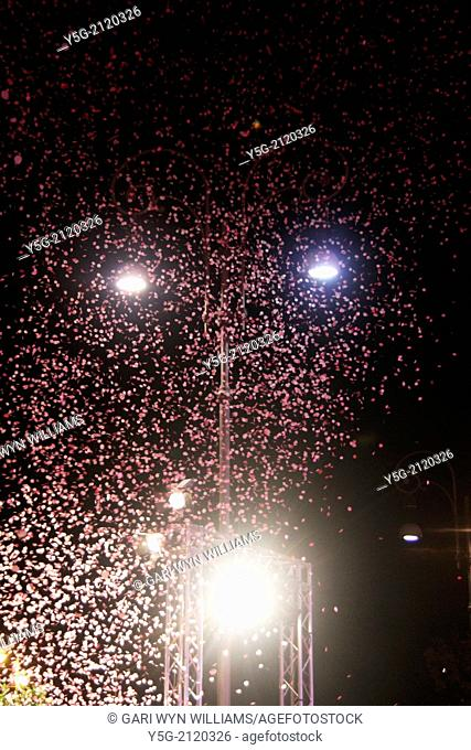 pink confetti in sky at event in rome italy