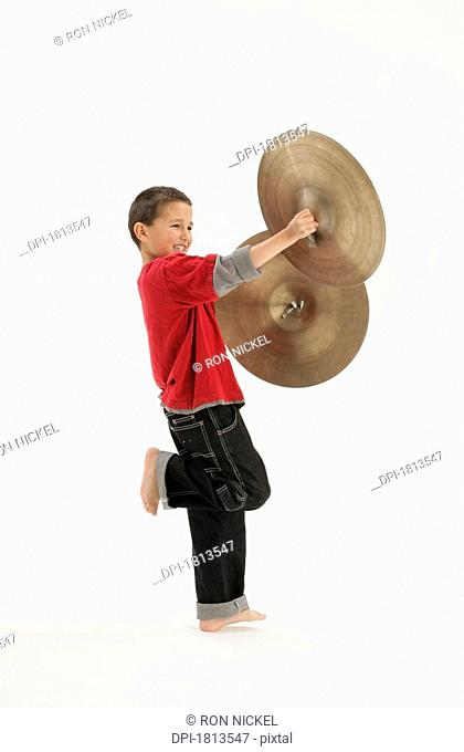 Boy holding cymbals