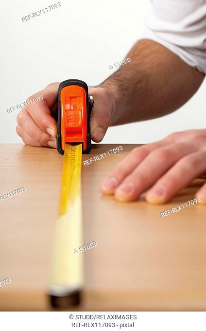 Man carpenter construction close up wood worker